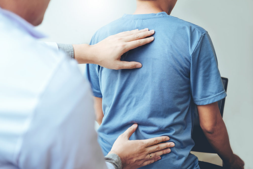 Doctor consulting with patient Back problems